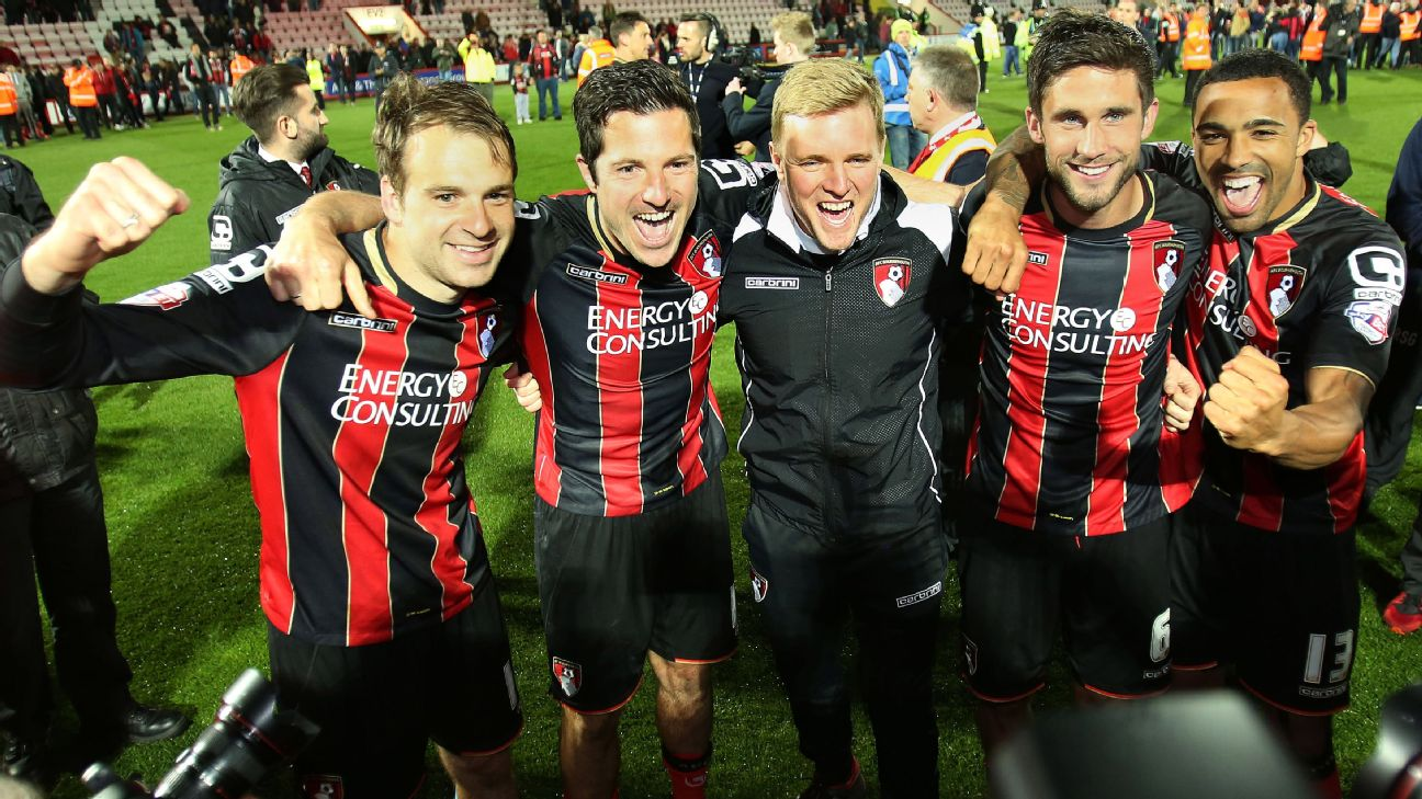 Bournemouth players and manager Eddie Howe pose for photographers.