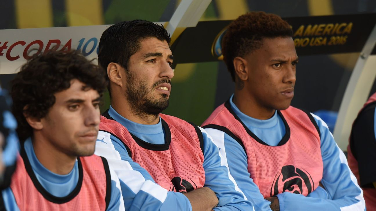Luis Suarez was forced to sit and watch as Uruguay fell to Venezuela