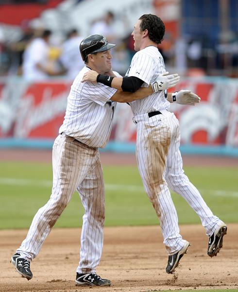 Chris Coughlan and Wes Helms celebrate Sunday