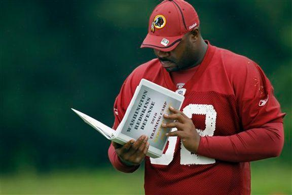 Haynesworth could be turning in his playbook before the season is over (AP Photo)