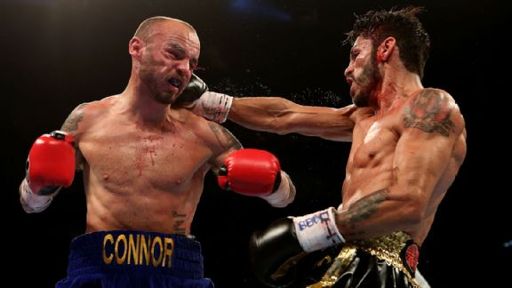 Kevin Mitchell of England and Jorge Linares of Venezuela exchange blows